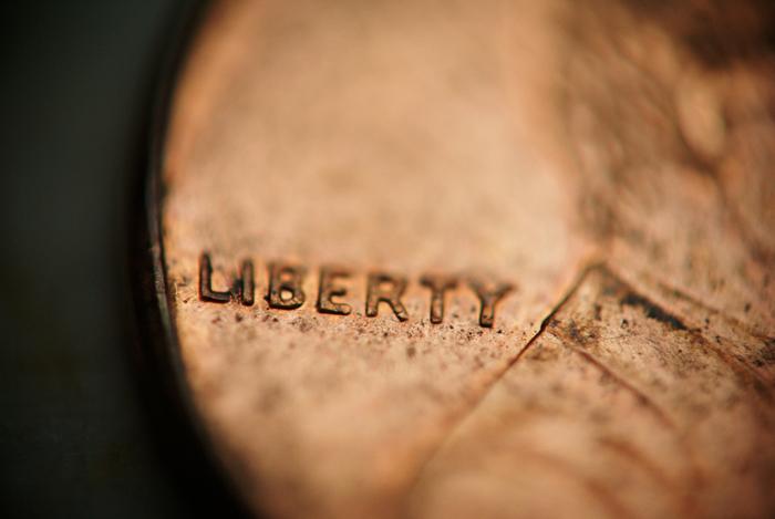 """Imagen de moneda con la palabra """"Liberty"""" para ilustrar Ilusiones preferentes"""